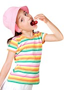 Girl eating cherries