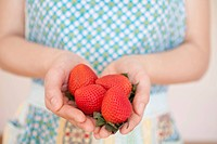 Strawberries on hands