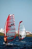 Two windsurfers