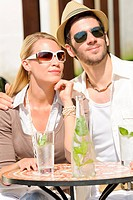 Restaurant terrace elegant couple drink sunny day