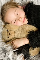 Sleeping girl with a teddybear