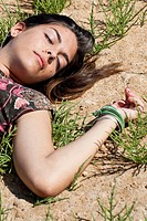 girl sleeping on grass