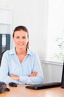 Businesswoman looking into camera in office