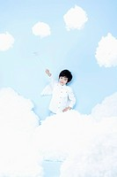 little boy looks of angel on the clouds