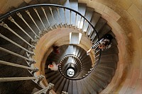 Tourist taking picture of spiral staircase inside the lighthouse Phare des Baleines on the island Ile de Ré, Charente_Maritime, France