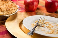 Apple Pie and Empty Plate with Remaining Crumbs