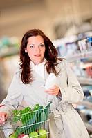Shopping series _ Young woman buying shampoo