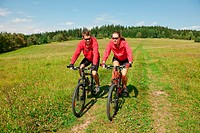 Summer _ young man woman couple ride mountain bike
