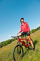 Summer _ young woman ride mountain bike