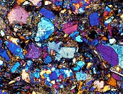 Polarised light micrograph of a thin section of ´Greywacke´, a sedimentary rock composed of variously sized fragments in a generally fine matrix. This...