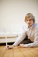 Man holding a miniature of wind wheel