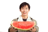 middle age asian farmer holding Watermelon isolate