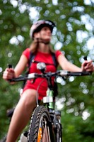 pretty young female biker outdors on her mountain bike