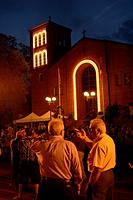 Two men talk in the late evening during St Angela Merici Church 25th Anniversary celebration weekend. The church is in the heart of Little Italy. Wind...