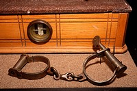 Handcuffs like these were used by police officers and federal agents to detain criminal suspects during the early 1900s  Exhibit by the DEA Museum and...