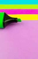 colour note papers with a green highlighter