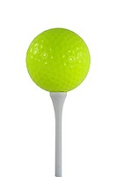 Isolated yellow golf ball on a white tee