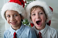 Boys wearing Santa hats, portrait