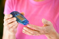 Woman testing blood sugar (thumbnail)