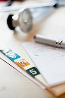 Close_up of prescription pad and medical charts.
