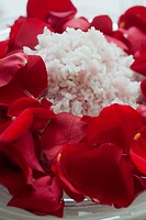 Cooked rice decorated with red rose petals