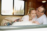 Couple snuggling in camper