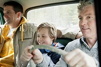Three generations of men on a road trip
