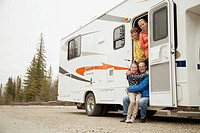 Family portrait at camper doorway