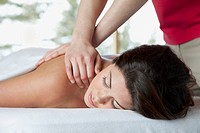 Pretty, mid_adult woman receiving a massage