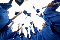 Graduates throwing caps in the air