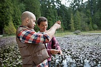 Father and son enjoying fishing together (thumbnail)