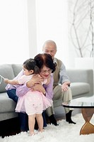 Grandparents with granddaughter 2_3 in living room