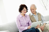 Middle_aged couple using digital tablet
