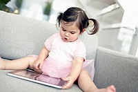 Girl 2_3 plying with digital tablet