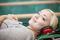 Pretty college student listening to music