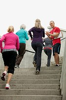 Mature women jogging up stairs