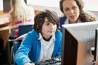 Teacher assisting middle school student on computer (thumbnail)