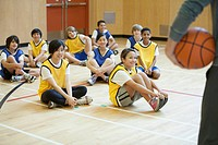 Group of middle school students sitting in gymnasium