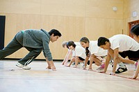 Teacher demonstrating sprinting position