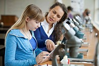 Teacher with student and microscopes (thumbnail)
