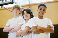 Three male teenage students posing in gymnasium (thumbnail)