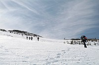 Spring hikers and skiers in the alpine zone on the Ammonoosuc Ravine Trail near Lakes of the Clouds Hut in the White Mountain National Forest of New H...
