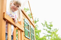 Five year old girl on wooden play structure