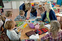 Girls and boys 6_7 taking part in art class