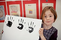 Girl 6-7 showing multiple hand prints (thumbnail)