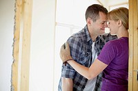 Couple being affectionate while renovating