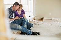 Mid adult couple making renovation choices (thumbnail)