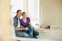 Mid adult couple making renovation choices