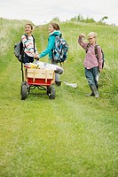 Elementary students pulling wagon with field trip supplies (thumbnail)