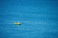 Fisherman in Blue and Yellow Boat